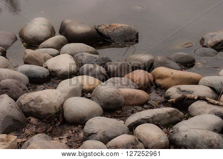 Stones In Water Background.