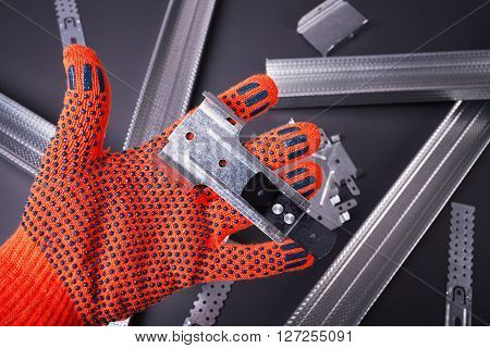 Hand in glove construction, profile for plasterboard, fixing plasterboard, set of building profiles, building materials, steel profiles for repair, construction works, personal protective equipment
