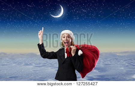 Santa woman with red bag