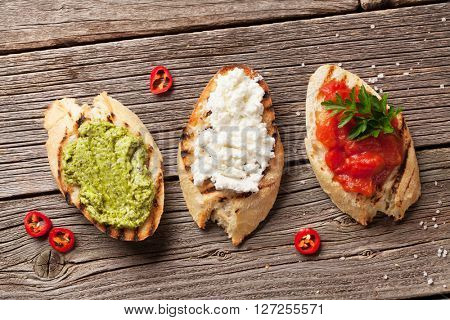 Toast sandwiches on wooden background. Top view