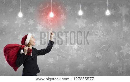 Businesswoman in Santa hat