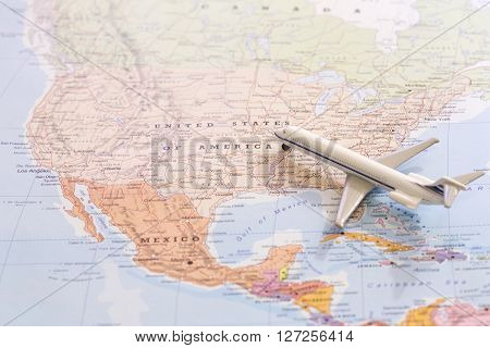 Miniature Of Passenger Airplane On A Map, Travel Destination Usa