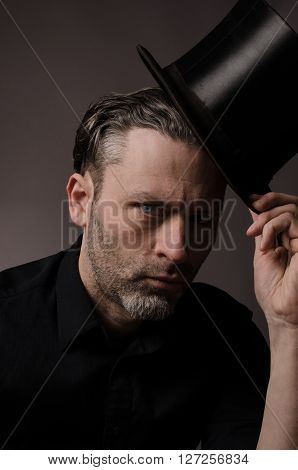 Handsome man with a black topper, studio shot