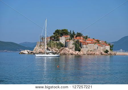 Sveti Stefan Old Town and sailboat moored, Montenegro