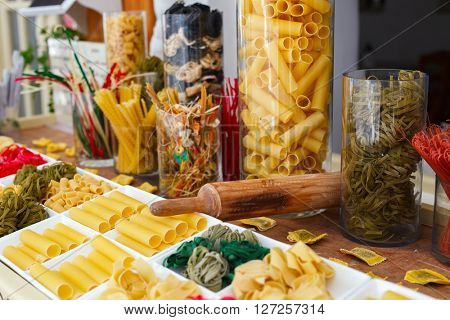 Variety of types and shapes of uncooked  Italian pasta
