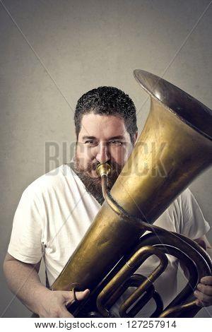 Chubby man playing music