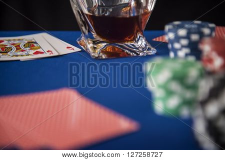 Gambling chips and poker cards in casino