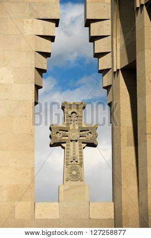 Christian cross against cloudy blue sky