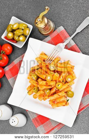 Tortellini with Ketchup and Green Olives Studio Photo