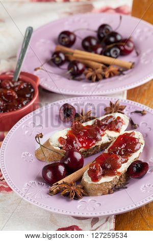 Bread with homemade spicy cherry jam. Shallow dof