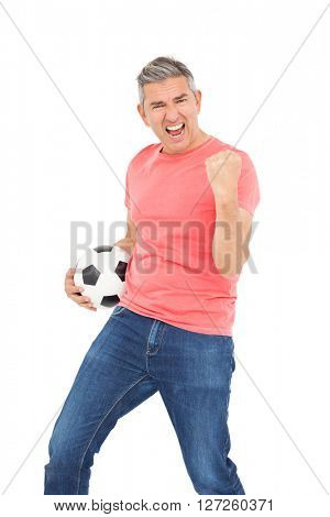 Happy guy holding a soccer ball on white screen