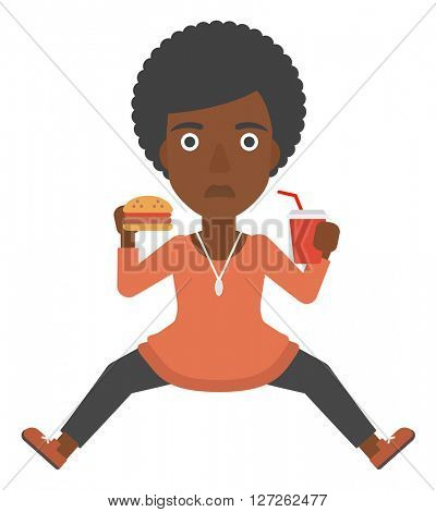 Woman eating hamburger.