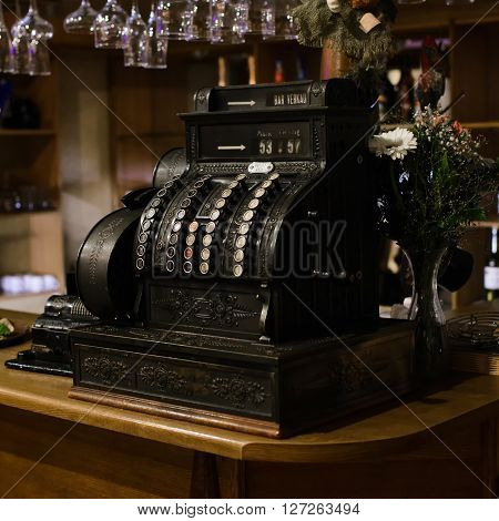 vintage Antique cash register standing on the bar