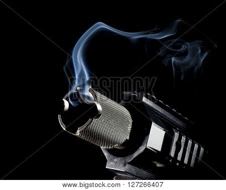 Modern semi automatic gun that has smoke coming from the barrel