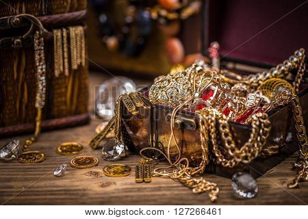 Pirate treasure chest full of jewellery, studio shot