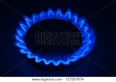 Gas burner burning in the dark closeup