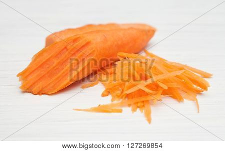 half carrot, grated carrots,food ingredients on white