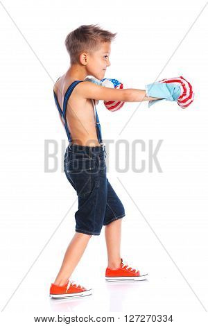 Cute little boxer boy wearing a boxer gloves. Isolated on a white backgrownd