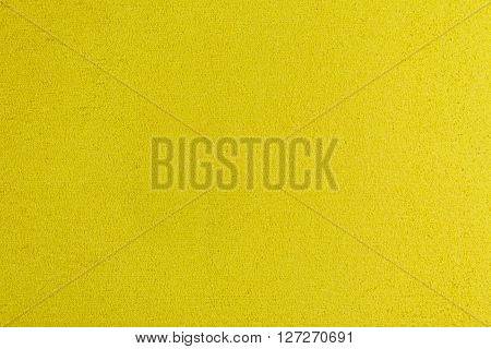 Eva foam ethylene vinyl acetate yellow surface sponge plush background