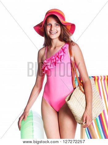 Cute girl in swimsuit and hat with bag. Isolated on white background