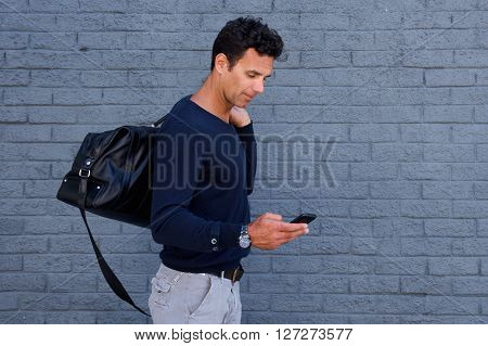 Male Traveler Walking With Cell Phone And Bag