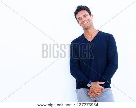 Handsome Rugged Man Laughing Against White Background