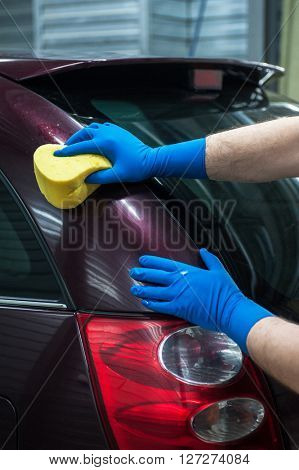 washing car with sponge