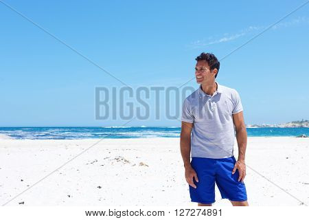 Good Looking Middle Aged Man Smiling At The Beach