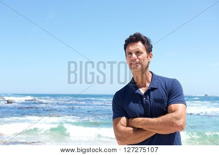 Rugged Middle Aged Man Standing At The Beach
