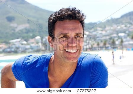 Close Up Portrait Of A Good Looking Middle Aged Man Smiling
