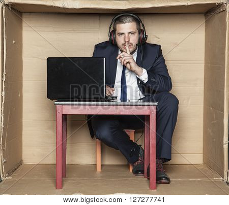 Businessman Does Gesture Of Silence