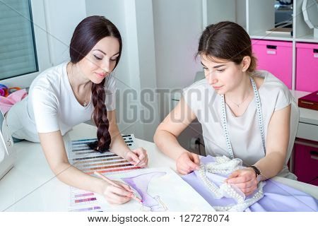Seamstresses Working In The Sewing Workshop
