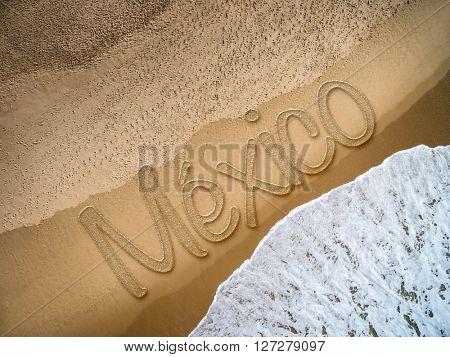 Mexico written on the beach
