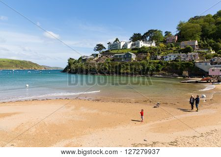 SALCOMBE, DEVON, ENGLAND-MAY  31ST  2015: Sunny summer weekend  weather drew visitors to the beach at South Sands, Salcombe, Devon on Sunday 31st May 2015