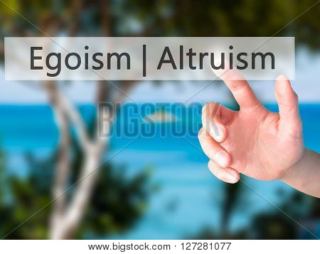 Altruism  Egoism  - Hand Pressing A Button On Blurred Background Concept On Visual Screen.