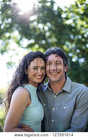 Portrait of smiling happy couple standing at park
