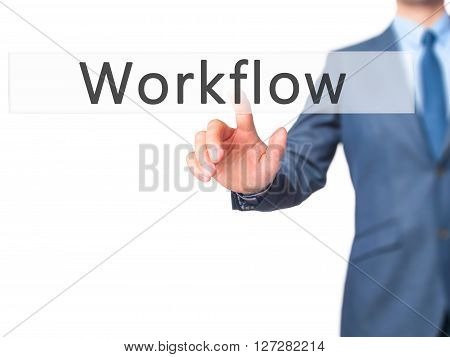 Workflow - Businessman Hand Pressing Button On Touch Screen Interface.