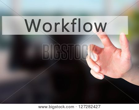 Workflow - Hand Pressing A Button On Blurred Background Concept On Visual Screen.