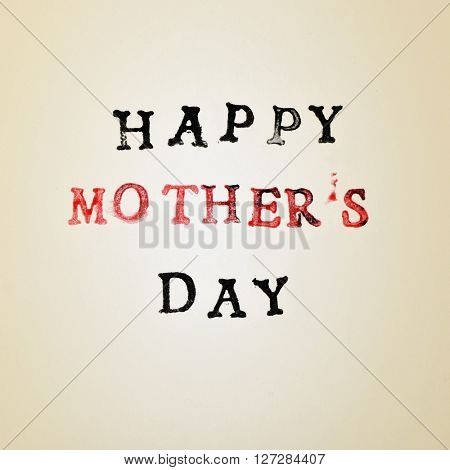 the text happy mothers day printed in black and red in a beige gradient background
