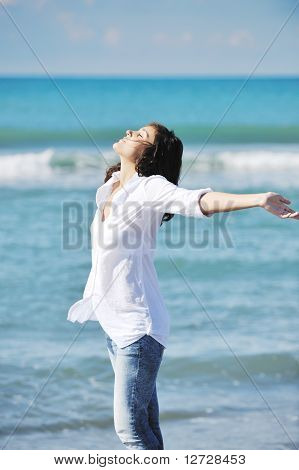 Happy Young Woman On Beach