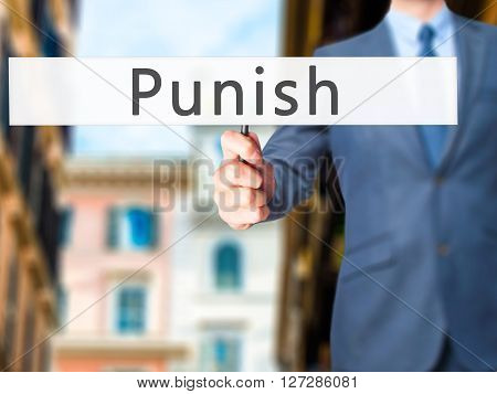 Punish - Businessman Hand Holding Sign