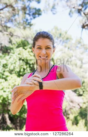 Woman checking her watch after jogging