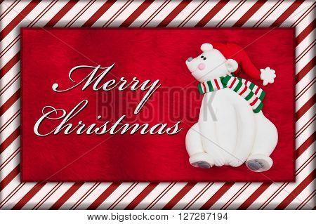 Merry Christmas Greeting Red Plush Fur Christmas Bear Christmas and Candy Cane Border with text Merry Christmas