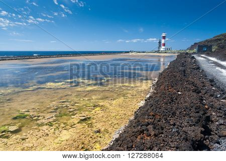 Salt extraction plant with lighthouse at salinas  La Palma - Canary islands.