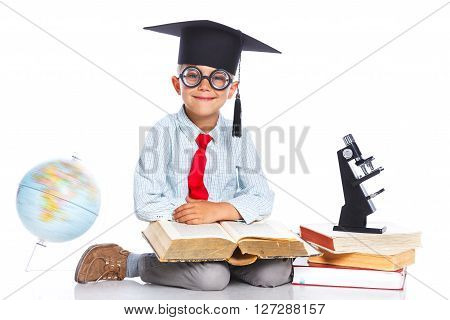 Little Professor boy in academic hat. Isolated on a white background
