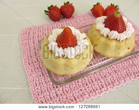 Small stuffed strawberry cakes with wipped cream
