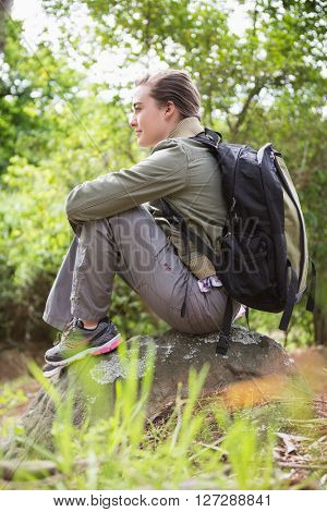 Woman sitting on a stone in the countryside