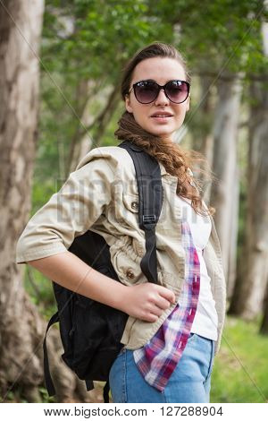 Woman with backpack and sunglasses in the countryside