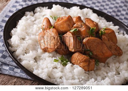 Adobo Chicken With Garnish Of Rice Close-up On A Plate. Horizontal