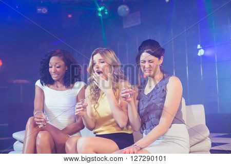 Pretty girls drinking alcohol in a nightclub